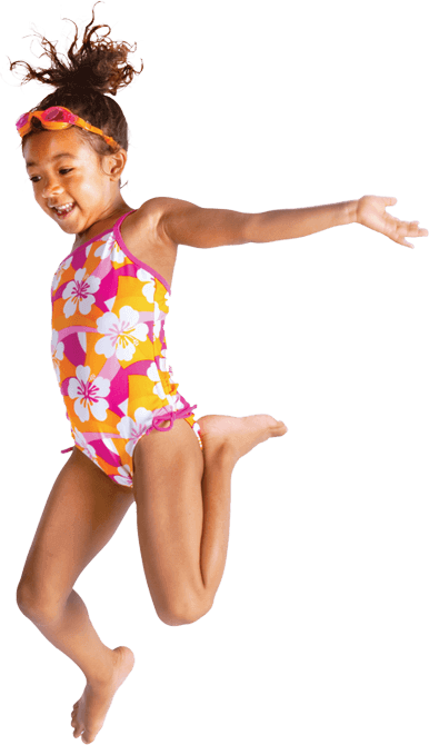 A smiling child in swimming clothes.